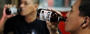 Men drink San Miguel beer at a bar in Taguig City, Metro Manila November 14, 2012. REUTERS/Cheryl Ravelo