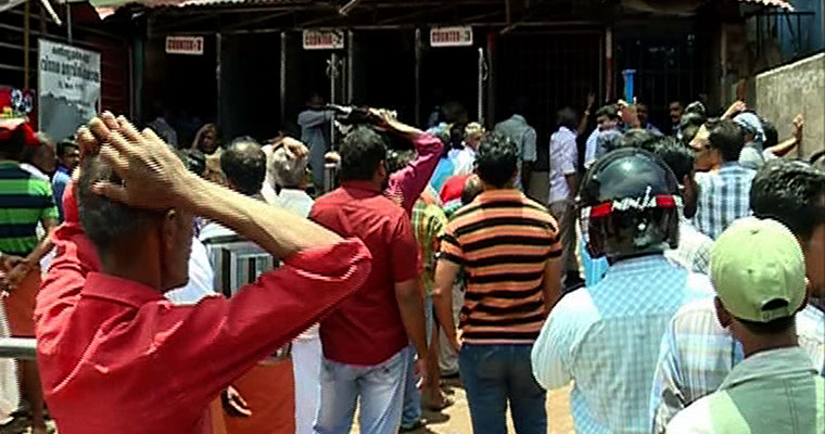 India. Cash raining at Kerala's liquor retailer; employees on the run with money